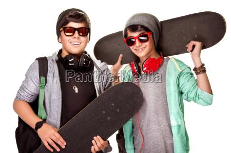 happy boys with skateboards