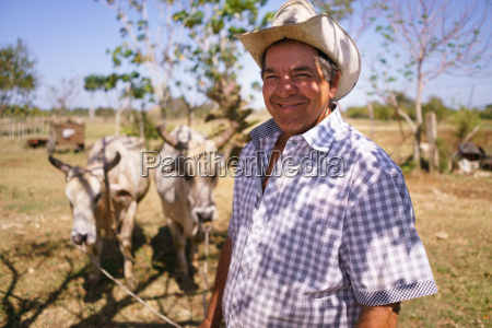 portrait happy man farmer at work