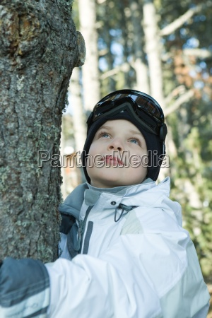 boy hugging tree