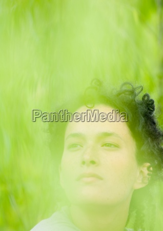 womans face green blur in foreground