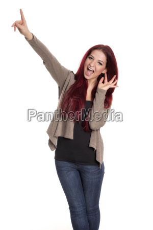 woman with red hair pointing upwards