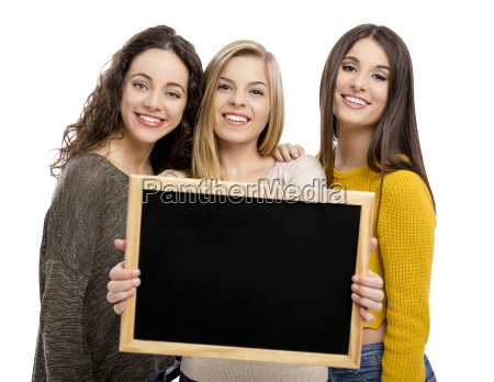 teenage girls holding a chalkboard