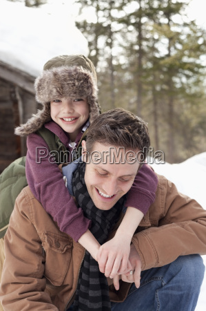 portrait of happy son hugging father