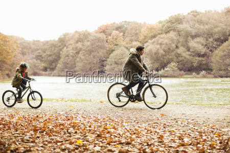 father and son riding bicycles in