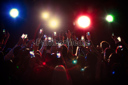 audience using camera phones at concert