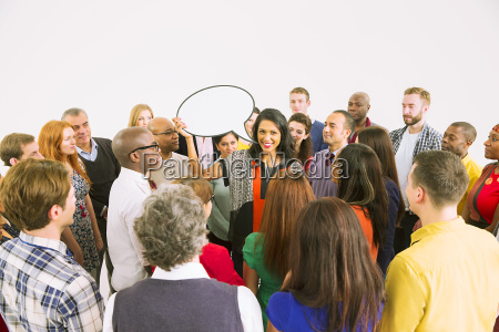 businesswoman with speech bubble in crowd