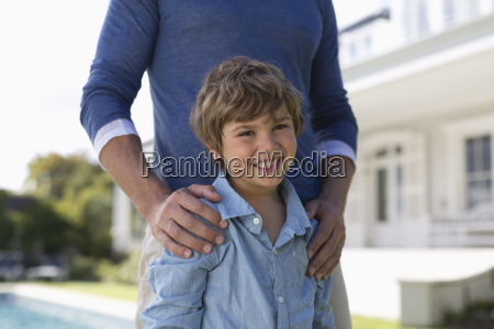 father and son standing outdoors