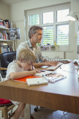 father and son working in home