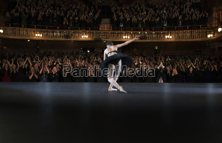 ballerina bowing on stage in