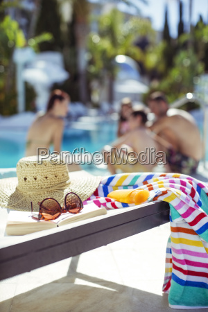 sunhat sunglasses book and colorful beach