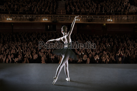 ballerina performing on stage in theater