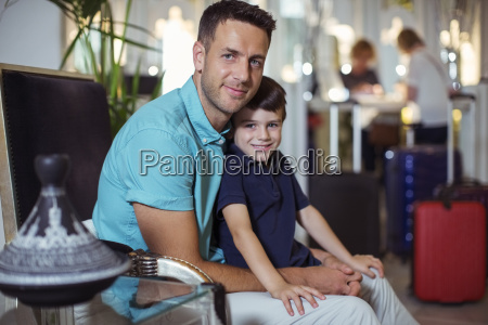portrait of man with son sitting
