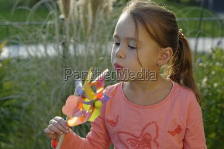 portrait of little girl with pinwheel