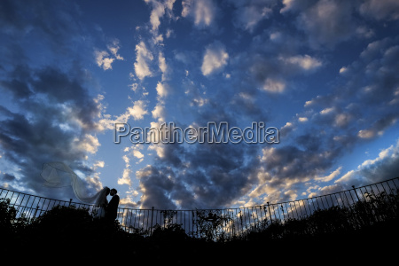 silhouette of young bridal couple with