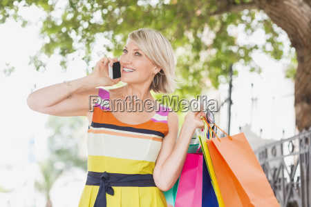 happy woman talking on phone with