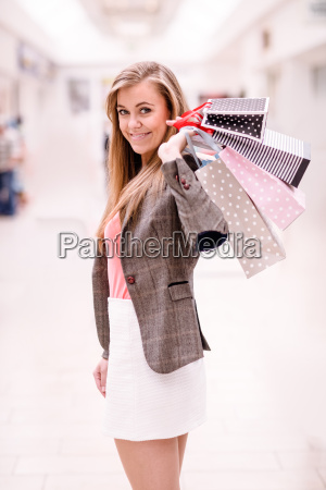 portrait of happy woman holding shopping