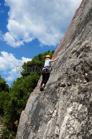 girl climbing on rocks