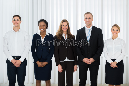 happy businesspeople at workplace