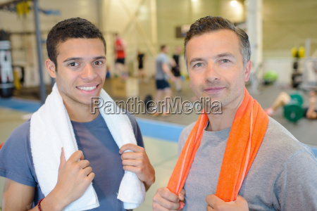 men in the gym with towel