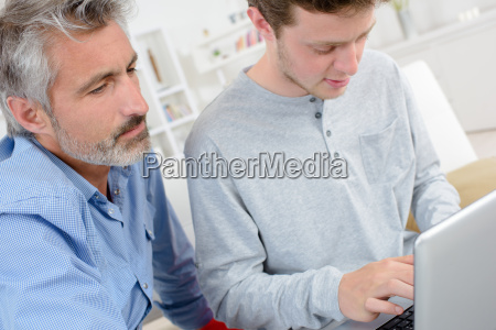 men in the house with laptop