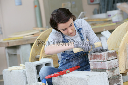 young woman in masonry professional school