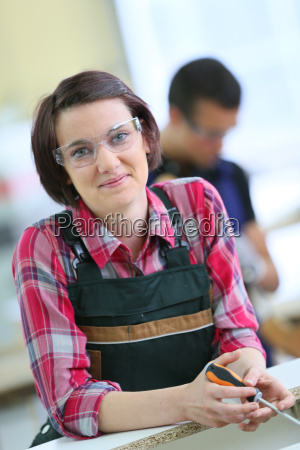 portrait of young woman in carpentry