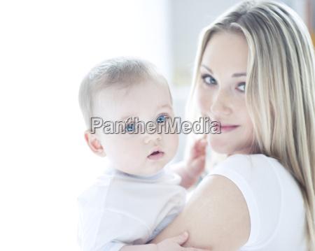 teenage girl holding baby boy portrait