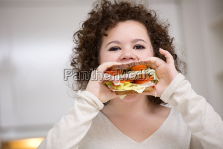 teenage girl eating sandwich portrait