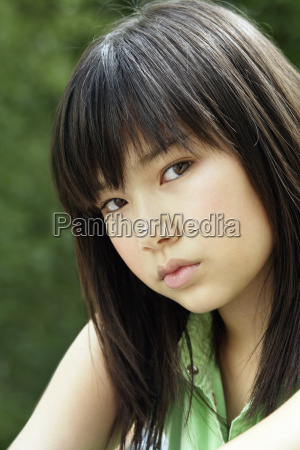 young asian girl outdoors portrait