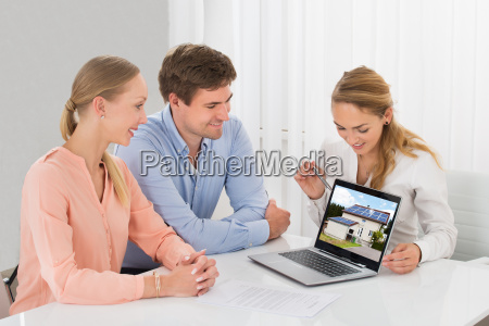 estate agent showing house to couple