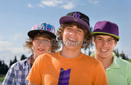 teen triplet boys smiling portrait