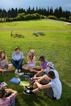 teen group sitting on grass