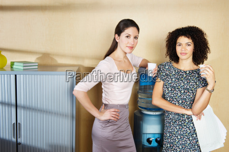 two women standing by water cooler