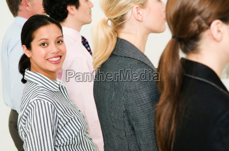 women in line of people smiles