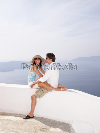 couple sitting on a low wall