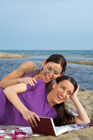 two young women on beach