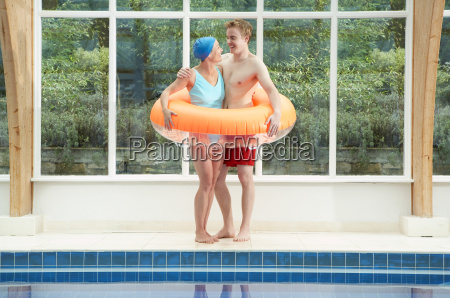couple standing in rubber ring by