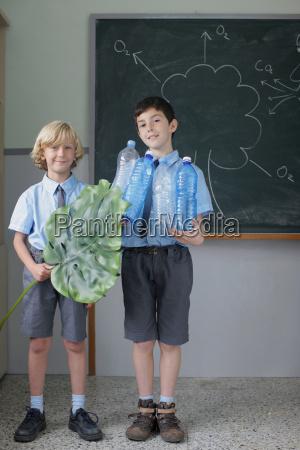 school boys giving science presentation
