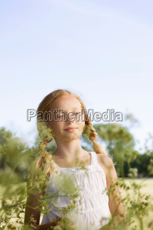 portrait of young girl with flowers