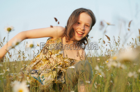 young girl laughing in field