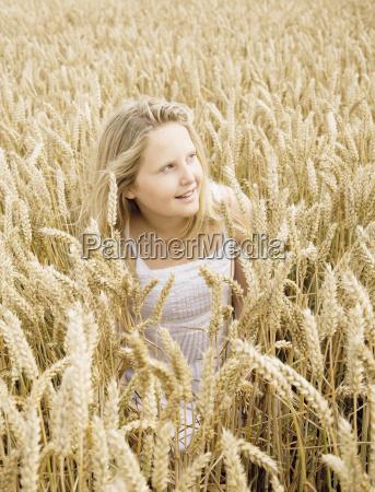 girl hiding in wheat field
