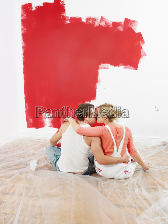 couple kissing while decorating