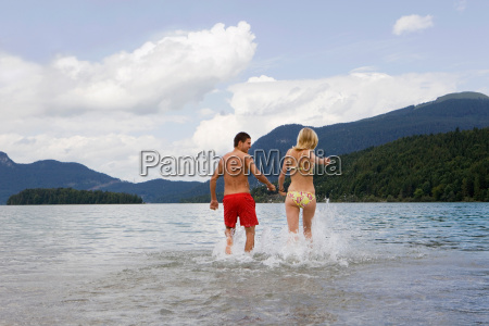 a couple running into the water