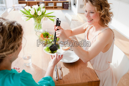 two woman at table with mixed