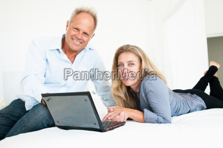 middle aged couple with laptop