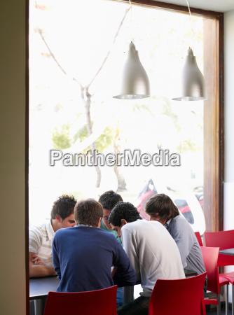 group of teenage males talking in