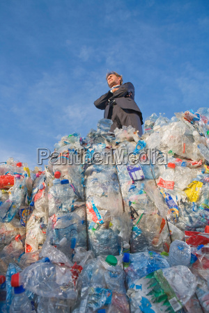businessman outdoors at a recycling plant