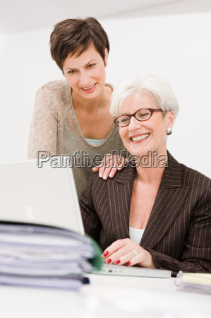 two women working together at a