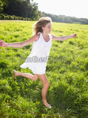 young woman running in a field