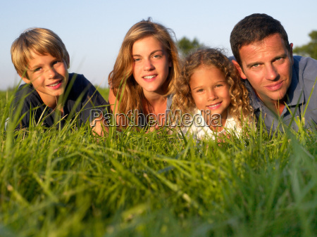 family lying in a field